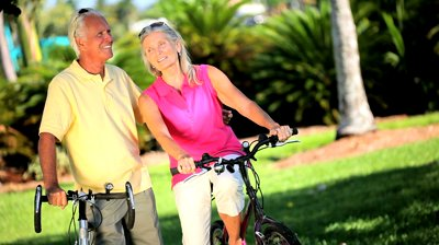 active senior couple enjoying cycling